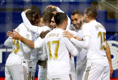 Real Madrid's French striker Karim Benzema (2-R) celebrates with teammates after scoring the opening goal against SD Eibar during their Spanish LaLiga Primera Division soccer match played at the Ipurua stadium in Eibar, northern Spain, 09 November 2019.