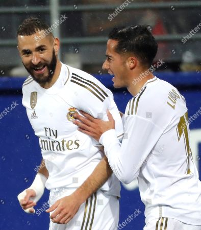 Real Madrid's French striker Karim Benzema (L) celebrates with Lucas Vazquez (R) after scoring the opening goal against SD Eibar during their Spanish LaLiga Primera Division soccer match played at the Ipurua stadium in Eibar, northern Spain, 09 November 2019.