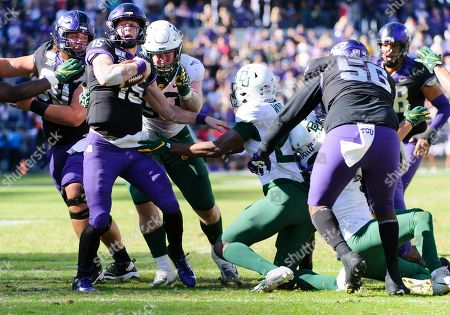 Stock Photo of Baylor Bears defensive tackle James Lynch (93) tackles TCU Horned Frogs quarterback Max Duggan (15) during overtime of the NCAA Football game between Baylor Bears and the TCU Horned Frogs at Amon G. Carter stadium in Fort Worth, Texas