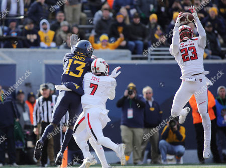 Texas Tech's Damarcus Fields (23) intercepts a pass intended for Sam James (13) during the third quarter of their NCAA college football game in Morgantown, W.Va
