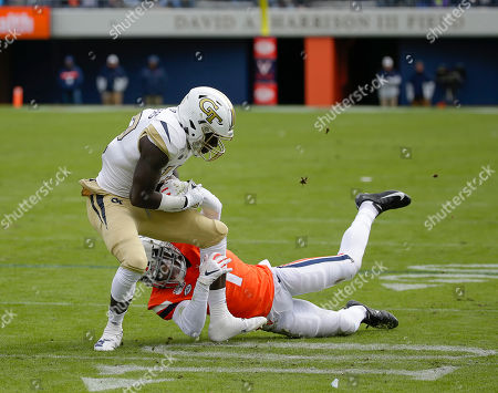 Georgia Tech Yellow Jackets WR #12 Adonicas Sanders is caught by Virginia Cavaliers CB #1 Nick Grant during a NCAA football game between the University of Virginia Cavaliers and the Georgia Tech Yellow Jackets at Scott Stadium in Charlottesville, Virginia
