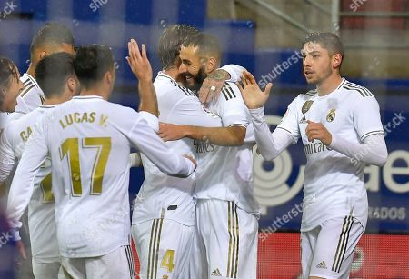 Real Madrid's players congratulate Karim Benzema, second right, after he scored his side's opening goal during the Spanish La Liga soccer match between Eibar and Real Madrid at Ipurua stadium, in Eibar, northern Spain