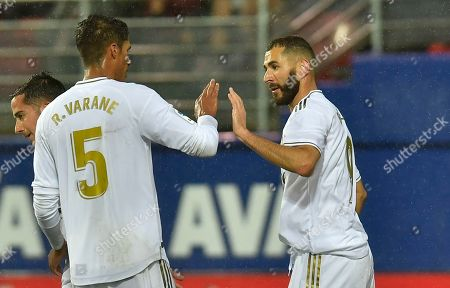 Real Madrid's Karim Benzema, right, celebrates after scoring his side's third goal during the Spanish La Liga soccer match between Eibar and Real Madrid at Ipurua stadium, in Eibar, northern Spain