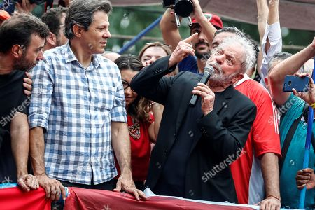 Stock Image of Brazilian former President Luiz Inacio Lula da Silva (R) speaks to supporters in Sao Bernardo do Campo, Brazil, 09 November 2019. Lula, who was convicted and sentenced to 12 years on charges of corruption and money laundering was released on 08 November following a ruling by the Supreme Court on 07 November. The Brazilian Supreme Court ruled on 07 November that a defendant could only be jailed after all of their appeals were exhausted. At left is former presidential candidate of the Workers' Party, Fernando Haddad.