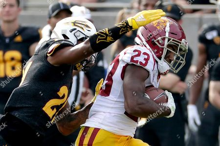 Southern California running back Kenan Christon (23) runs for a touchdown as Arizona State defensive back Jack Jones (21) defends during the first half of an NCAA college football game, in Tempe, Ariz