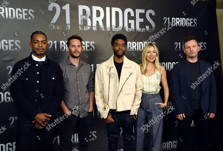 """Brian Kirk, Stephan James, Taylor Kitsch, Chadwick Boseman, Sienna Miller. Brian Kirk, far right, director of """"21 Bridges,"""" poses with cast members, from left, Stephan James, Taylor Kitsch, Chadwick Boseman and Sienna Miller during a photo call for the film at the Four Seasons Hotel, in Los Angeles"""
