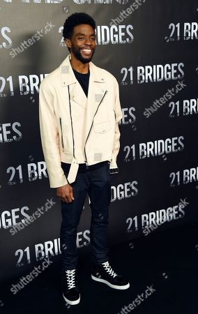"""Chadwick Boseman, a cast member in """"21 Bridges,"""" poses during a photo call for the film at the Four Seasons Hotel, in Los Angeles"""