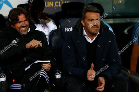 Celta Vigo's head coach Oscar Garcia, right, flashes a thumbs up prior to a Spanish La Liga soccer match between Barcelona and Celta at Camp Nou stadium in Barcelona