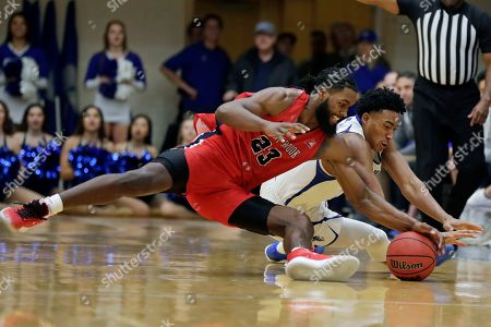 Stock Image of Stony Brook guard Andrew Garcia (23) and Seton Hall guard Jared Rhoden dive for a loose ball during the second half of an NCAA college basketball game, in South Orange, N.J. Seton Hall won 74-57