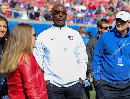 Stock Photo of SMU legend Eric Dickerson watches from the sidelines during the NCAA football game between the SMU Mustangs and the ECU Pirates at Gerald J. Ford Stadium in Dallas, TX