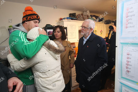 British Labour Party leader Jeremy Corbyn (R) and MP Caroline Flint (C) meet residents James (L) and Alison Merritt (C) in their house which was affected by flooding in Conisborough, South Yorkshire, Britain, 09 Novemb?er 2019. Britons go to the polls on 12 December in a general election.