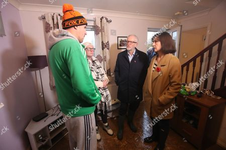 British Labour Party leader Jeremy Corbyn (C) and MP Caroline Flint (R) meet residents James (L) and Alison Merritt (C-L) in their house which was affected by flooding in Conisborough, South Yorkshire, Britain, 09 Novemb?er 2019. Britons go to the polls on 12 December in a general election.