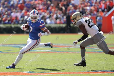 Stock Picture of Florida tight end Lucas Krull (7) runs after a reception as Vanderbilt defensive back Allan George (28) tries to stop him during the first half of an NCAA college football game, in Gainesville, Fla