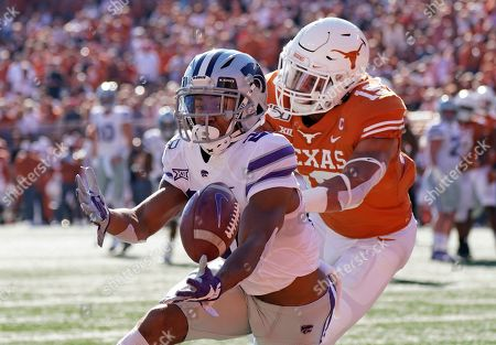 Kansas State's Wykeen Gill (21) hauls in a pass for a touchdown in front of Texas's Brandon Jones (19) during the first half of an NCAA college football game in Austin, Texas