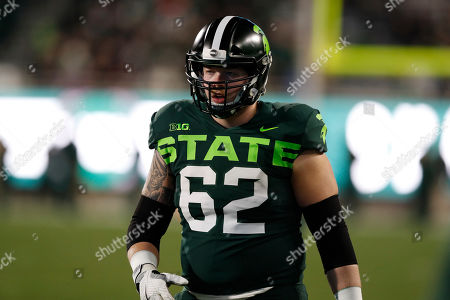 Michigan State offensive lineman Luke Campbell is seen during the second half of an NCAA college football game, in East Lansing, Mich