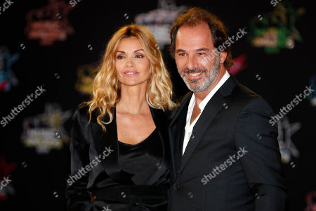 Ingrid Chauvin (L) and her husband, French director Thierry Peythieu (R) arrive for the 21st NRJ Music Awards at the Palais des Festivals in Cannes, France, 09 November 2019.