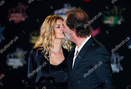 Stock Picture of Ingrid Chauvin (L) and her husband, French director Thierry Peythieu (R) arrive for the 21st NRJ Music Awards at the Palais des Festivals in Cannes, France, 09 November 2019.