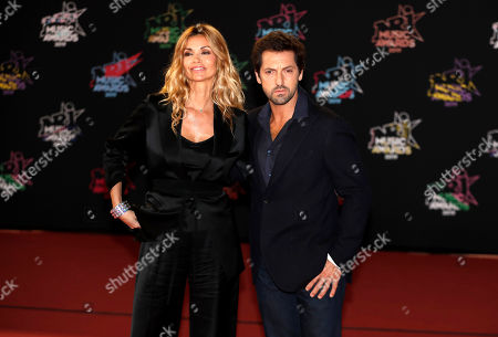 Ingrid Chauvin (L) and French actor Frederic Diefenthal (R) arrive for the 21st NRJ Music Awards at the Palais des Festivals in Cannes, France, 09 November 2019.