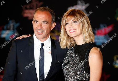 Stock Picture of French TV host Nikos Aliagas (L) and his partner Tina Grigoriou (R) arrive for the 21st NRJ Music Awards at the Palais des Festivals in Cannes, France, 09 November 2019.
