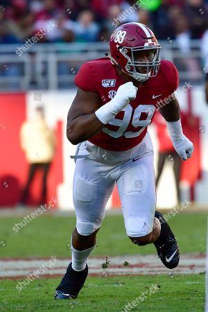 Stock Photo of Alabama defensive lineman Raekwon Davis (99) rushes the LSU quarterback in an NCAA football game, in Tuscaloosa, Ala. LSU won 46-41