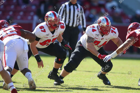 Western Kentucky offensive lineman Seth Joest #67 and Tyler Witt #74 come off the line as the ball is put in play. Western Kentucky defeated Arkansas 45-19 in Fayetteville, AR, Richey Miller/CSM