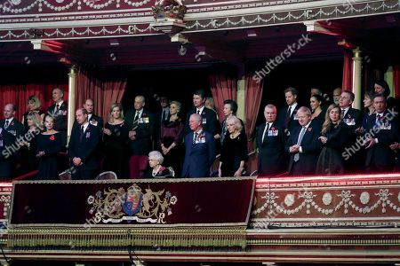 Stock Picture of Queen Elizabeth II (C), with (L-R) Catherine Duchess of Cambridge, Prince William, Prince Edward, Sophie Countess of Wessex, Birgitte, Duchess of Gloucester, Sir Tim Laurence, Prince Charles, Princess Anne, Camilla Duchess of Cornwall, Prince Andrew, Boris Johnson, Prince Harry, Meghan Duchess of Sussex and Carrie Symonds attend the annual Royal British Legion Festival of Remembrance at the Royal Albert Hall