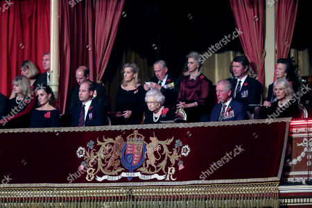 Queen Elizabeth II (C), with (L-R) Catherine Duchess of Cambridge, Prince William, Prince Edward, Sophie Countess of Wessex, Birgitte, Duchess of Gloucester, Sir Tim Laurence, Prince Charles, Princess Anne Camilla Duchess of Cornwall attend the annual Royal British Legion Festival of Remembrance at the Royal Albert Hall
