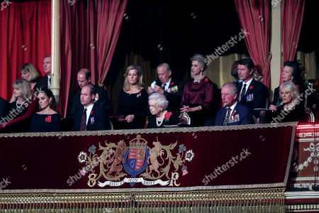 Queen Elizabeth II (C), with (L-R) Catherine Duchess of Cambridge, Prince William, Prince Edward, Sophie Countess of Wessex, Birgitte, Duchess of Gloucester, Sir Tim Laurence, Prince Charles, Camilla Duchess of Cornwall attend the annual Royal British Legion Festival of Remembrance at the Royal Albert Hall