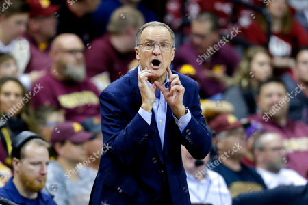 Oklahoma coach Lon Kruger calls instructions during the second half of an NCAA college basketball game against Minnesota in Sioux Falls, S.D