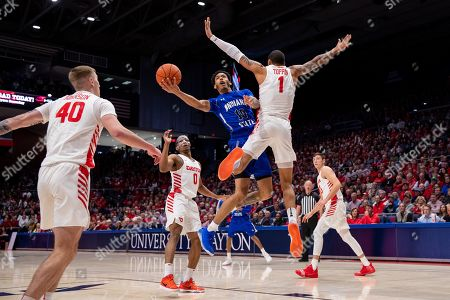 Christian Williams (10) of the Indiana State Sycamores lays the ball up as Obi Toppin (1) of the Dayton Flyers defends during game action between the Indiana State Sycamores and the Dayton Flyers at University of Dayton Arena on , in Dayton, OH