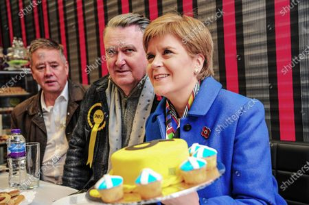 Keith Brown, John Nicolson and First Minister Nicola Sturgeon hold an SNP decorated cake during John Nicolson's election campaign ahead of the 2019 General Election.