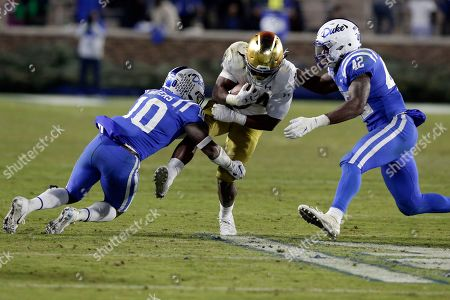 Stock Picture of Notre Dame running back Jahmir Smith (34) runs the ball while Duke safety Marquis Waters (10) and Duke linebacker Shaka Heyward (42) look for the tackle during the second half of an NCAA college football game in Durham, N.C
