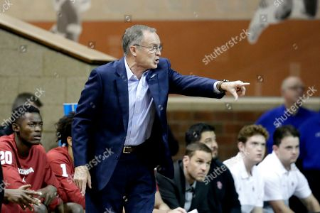 Oklahoma coach Lon Kruger calls instructions during the first half of an NCAA college basketball game against Minnesota in Sioux Falls, S.D