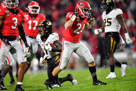 Georgia linebacker Matthew Brown (24) celebrates tacling Missouri running back Tyler Badie (1) during an NCAA college football game, in Athens, Ga
