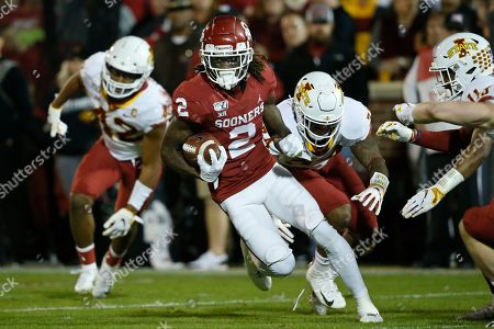 CeeDee Lamb, Marcel Spears Jr., O'Rien Vance, Lawrence White. Oklahoma wide receiver CeeDee Lamb (2) carries past Iowa State linebacker Marcel Spears Jr., linebacker O'Rien Vance and defensive back Lawrence White, from left, during the first quarter of an NCAA college football game in Norman, Okla