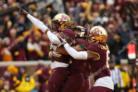 Jordan Howden, Antoine Winfield Jr., Chris Williamson. Minnesota defensive back Jordan Howden, left, celebrates with teammates Antoine Winfield Jr., center, and Chris Williamson, right, after they stopped Penn State from scoring during an NCAA college football game, in Minneapolis. Minnesota won 31-26