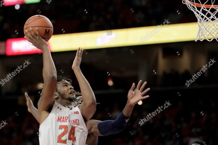 Stock Picture of Maryland forward Donta Scott (24) goes up to shoot as Rhode Island forward Jermaine Harris, back, defends during the first half of an NCAA college basketball game, in College Park, Md