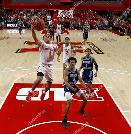 Maryland guard Anthony Cowan Jr. (1) goes up for a shot as Rhode Island guard Jeff Dowtin (11) and guard Fatts Russell (1) watch during the second half of an NCAA college basketball game, in College Park, Md. Maryland won 73-55