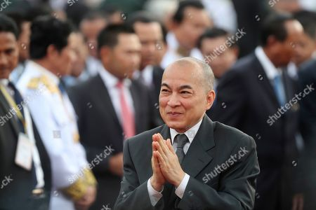 Cambodia's King Norodom Sihamoni, center, greets as he arrives for the water festival in Phnom Penh, Cambodia,. The three-day annual festival is to dedicate to the kingdom's ancestral naval warriors