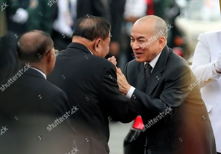Norodom Sihamoni, Say Chhum. Cambodia's King Norodom Sihamoni, right, greets his Senate President Say Chhum, center, as he arrives for the water festival in Phnom Penh, Cambodia,. The three-day annual festival is to dedicate to the kingdom's ancestral naval warriors