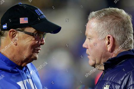 Duke head coach David Cutcliffe, left, and Notre Dame head coach Brian Kelly speak prior to an NCAA college football game in Durham, N.C
