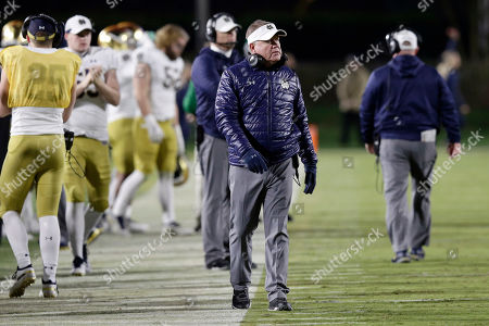 Notre Dame head coach Brian Kelly looks on during the first half of an NCAA college football game against Duke in Durham, N.C