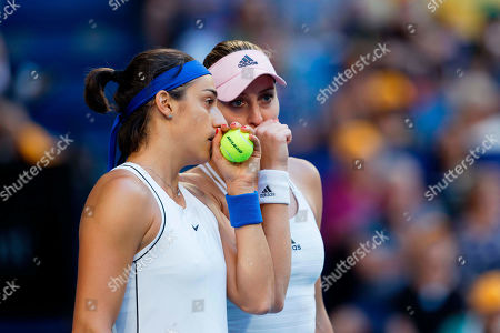 Caroline Garcia, Kristina Mladenovic. France's Caroline Garcia and France's Kristina Mladenovic talk during their match against Australia's Ash Barty and Sam Stosur in their Fed Cup tennis final in Perth, Australia