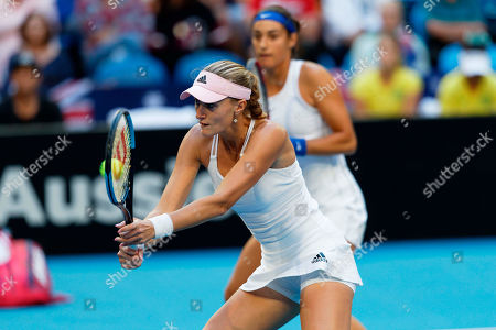 Caroline Garcia, Kristina Mladenovic. France's Kristina Mladenovic plays a backhand watched by Caroline Garcia during their match against Australia's Ash Barty and Sam Stosur in their Fed Cup tennis final in Perth, Australia