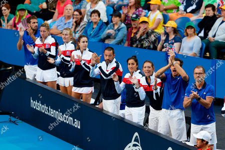 Caroline Garcia, Kristina Mladenovic. French players and officials cheer from the sidelines as Caroline Garcia and Kristina Mladenovic play in their match against Australia's Ash Barty and Sam Stosur in the Fed Cup tennis final in Perth, Australia