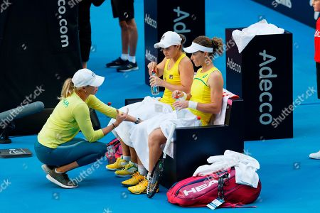 Stock Photo of Australian captain Alicia Molik urges her players Ash Barty and Samantha Stosur during a points break during their Fed Cup tennis final in Perth, Australia