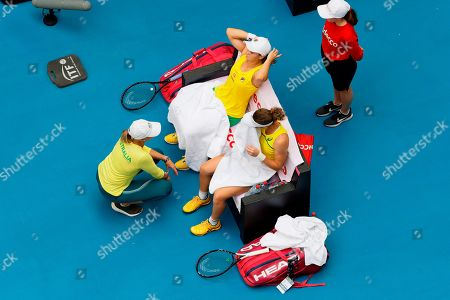 Australian captain Alicia Molik urges her players Ash Barty and Sam Stosur during a points break in their Fed Cup tennis final in Perth, Australia