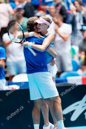 France's Kristina Mladenovic hugs French captain Julien Benneteau after winning her match against Australia's Ash Barty during their Fed Cup tennis final in Perth, Australia