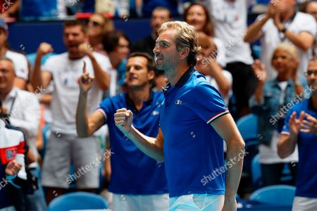 French captain Julien Benneteau reacts as he watches Kristina Mladenovic in her match against Australia's Ash Barty during their Fed Cup tennis final in Perth, Australia