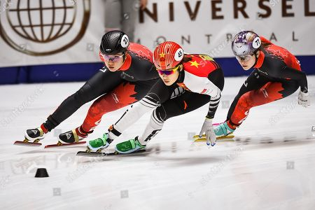 Courtney Lee Sarault (CAN) tries to pass Chutong Zhang (CHN) during the ISU World Cup II at Maurice-Richard Arena in Montreal, Quebec